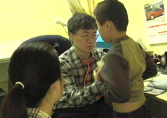 Dr. C. Y. Ngan seeing a patient